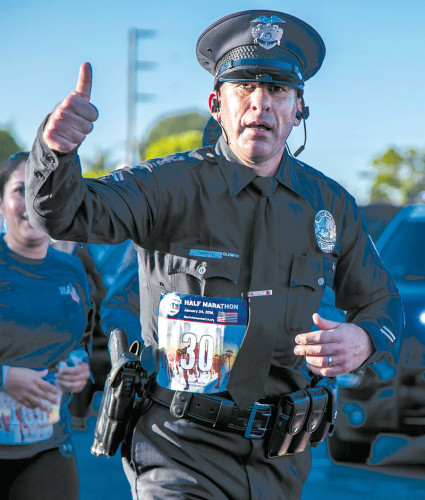 "Officer Joe Cirrito of the LAPD's Olympic Division ran in the ""Run to Remember"" in uniform last Sunday to honor his friend who died on 9/11. Cirrito plans to do the same in the Los Angeles Marathon on Feb. 14. (photo courtesy of Joe Cirrito)"