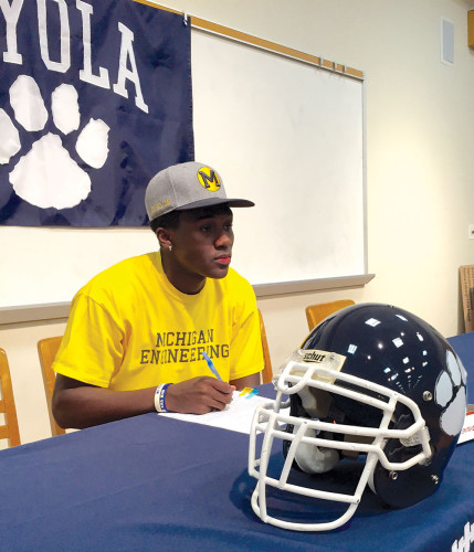 Loyola High School senior David Long signed his letter of intent Wednesday morning to play football for the University of Michigan. (photo by Melvin RoberT)