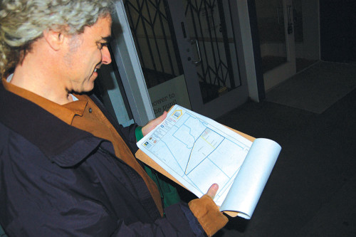 Mid City West Community Council board member Steve Luftman checks the tract map while he participates in the homeless count. (photo by Gregory Cornfield)