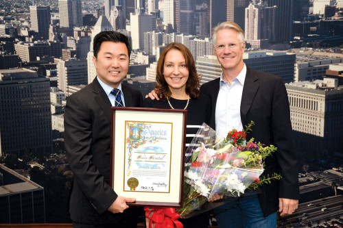 Councilman David Ryu honored Cindy Chvatal, above with her husband John Keane, for her decades of service to the community. (photo courtesy of Councilman David Ryu's office)