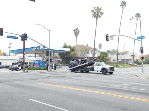 The intersection of Normandie and Melrose Avenues was closed for hours as police investigated the robbery and collision. (photo by Edwin Folven)
