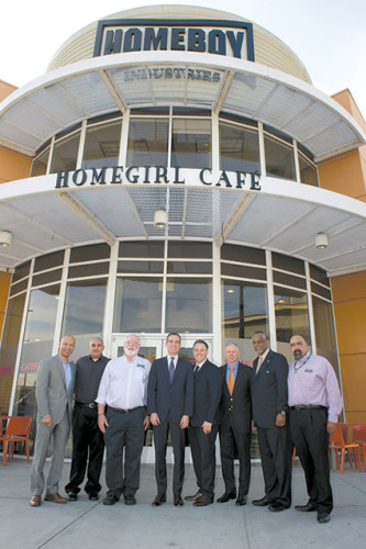 Father Greg Boyle (third from left), founder of Homeboy Industries, and Mayor Eric Garcetti (fourth from left) came together with city officials and representatives of solar panel companies to celebrate a $100,000 investment in Homeboy's solar panel installation training program. (photo courtesy of Homeboy Industries)