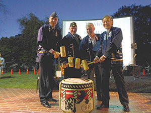 """Celebrating the event opening with the """"Kagamiwari"""" ceremony (breaking open the sake barrell) are, from left, Colonel James Bell, Space and Missile System Center, Los Angeles Air Force Base; Karl Risinger, Adjutant of the Hollywood American Legion Post 43; Richard Weir (Lt. Col. Ret.), Northrop Grumman Corporation; Consul General of Japan, Harry H. Horinouchi. (photo courtesy of Brian Swrods, Japanese Counsulate)"""
