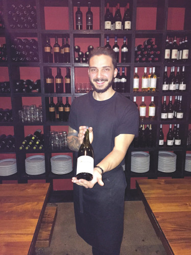 Sommelier Emanuele Rizzo pairs excellent Italian wine with authentic Italian cuisine at Pizza Romana. (photo by Jill Weinlein)