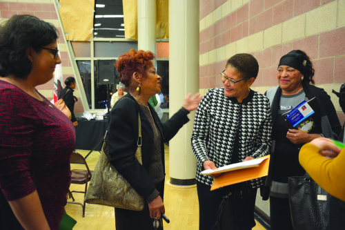 """Congresswoman Karen Bass, D-Calif., laughs with Miracle Mile residents on Tuesday at the """"Congressional Conversation Series."""" (photo by Patricia Sanchez)"""