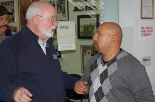 Homeboy Industries clients receive job experience, and Father Gregory Boyle offers guidance. (photo by Edwin Folven)