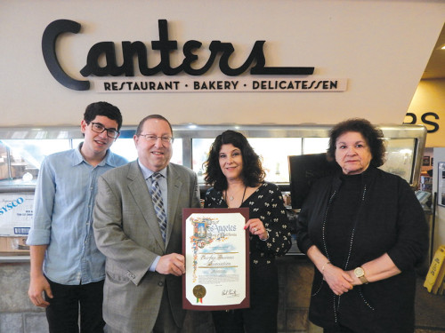 Councilman Paul Koretz (second from left) presented a proclamation to Jacqueline Canter and Ruth Williams, co-founders of the Fairfax Business Association (FBA). Pictured at left is Jacqueline's nephew Alex Canter, who has been appointed as vice president of the FBA. (photo by Edwin Folven)