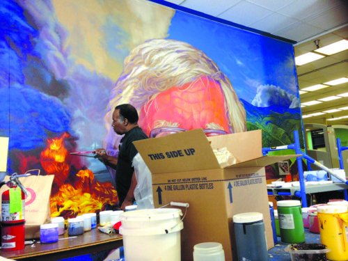 Artist Richard Wyatt put the finishing touches Wednesday on a Ray Bradbury mural at Los Angeles High School. The artist worked with students on painting the mural. It will be unveiled Thursday evening. (photo courtesy of Joyce Kleifield)