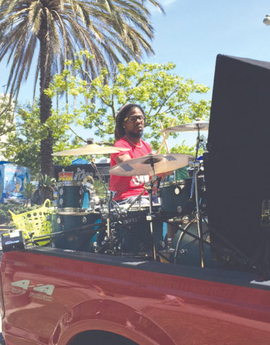 "Anthony Sheriff, who performs under the name ""Sheriff Drumman,"" played drums on the back of his 1999 Ford F250 near the La Brea Tar Pits on Tuesday afternoon. (Photo by Justin Sayles)"