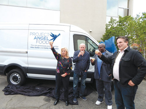 Jazz musician Corky Hale (left) and her husband, songwriter Mike Stoller, toasted the unveiling of Project Angel Food's new delivery van with driver Bert Cole and the organization's executive director Richard Ayoub. (photo by Edwin Folven)