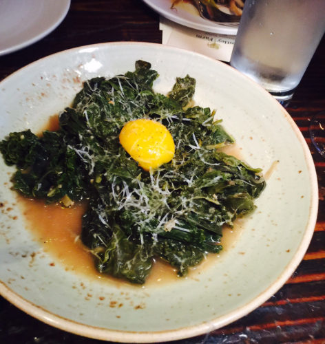 The braised kale and rainbow chard salad is topped with an egg and ...