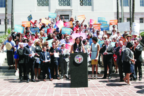 "Above, Isa Noyola, director of programs for Transgender Law Center, speaks at the Transform California celebration in front of city hall in April. U.S. Rep. Adam Schiff (D-Calif) said the Department of Justice lawsuit filed this week ""is about basic dignity and equality under the law."" (photo courtesy of Equality California)"