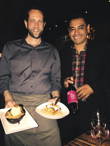 Our server Phillip, left, and Alex Osorio, the assistant manager and sommelier at Napa Valley Grille, shared expert knowledge on the wine and the courses we enjoyed. (photo by Jill Weinlein)