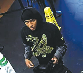 A surveillance camera captured an image of the robbery suspect. (photo courtesy of the LAPD)