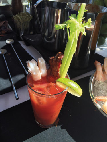 Build your own bloody Mary at Sonoma Wine Garden. Smoked bacon, jumbo shrimp and pickled vegetables are great additions. (photo by Jill Weinlein)