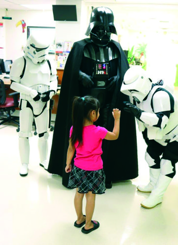 Darth Vader, a Stormtrooper and Biker Scout meet a fearless young girl on the pediatrics unit at Dignity Health – California Hospital Medical Center. (courtesy of Dignity Health California Hospital Medical Center)