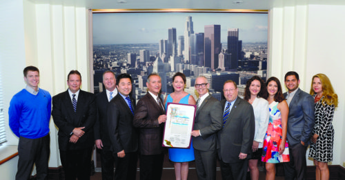 From left, Gregory Cornfield, Edwin Folven, L.A. County Assessor Prang, Councilman Ryu, Michael and Karen Villalpando, Councilmen O'Farrell and Koretz, Rebecca and Emily Villalpando, Michael Jilg and Jill Weinlein join at city hall to celebrate Park Labrea News and its 70th Anniversary. (photo by Sheri Mandel)