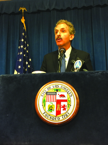 City Attorney Mike Feuer discusses the negative consequences of converting apartments into short-term rentals, and the effects it has on the housing crisis. (photo by Gregory Cornfield)