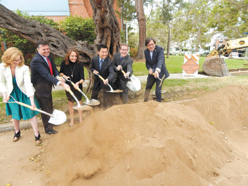 City officials and community members shoveled dirt during the groundbreaking for the concrete street repair project. Pictured are Sarah Dusseault (left), chief of staff for Councilman David Ryu; Greg Spotts, assistant director of the Bureau of Street Services; Cindy Chvatal, president of the Hancock Park Homeowners Association; Councilman David Ryu; Public Works Commission president Kevin James; and Bureau of Street Services director Nazario Sauceda. (photo by Edwin Folven)