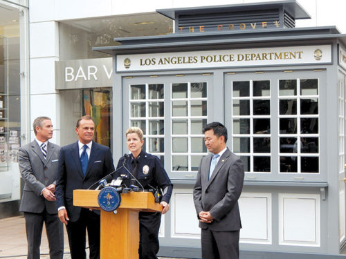 LAPD assistant chief Beatrice Girmala said the new koban will allow more interaction between visitors and officers at The Grove and the Original Farmers Market. She was joined by Deputy Mayor Jeff Gorell (left), Rick Caruso, founder and CEO of Caruso Affiliated, and Councilman David Ryu, 4th District.  (photo by Edwin Folven)