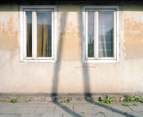 A photograph of a building in a former Jewish ghetto in Radom, Poland is featured in the exhibit at LAMOTH. (photo by Jamie Feiler)