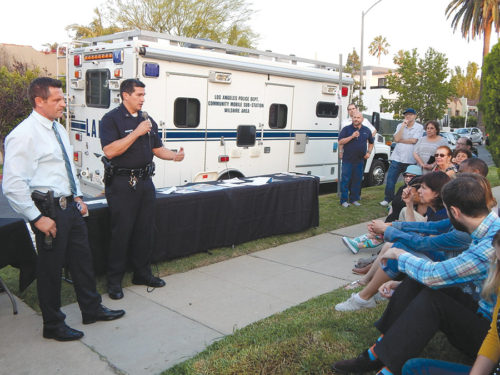 """Wilshire Division Capt. Rolando Solano discussed crime concerns in the Melrose District with residents at """"LAPD On Your Corner,"""" an event organized by the Melrose Action Neighborhood Watch. Also pictured is Det. Joe Alves, head of the Wilshire Division's Burglary Unit. (photo by Edwin Folven)"""