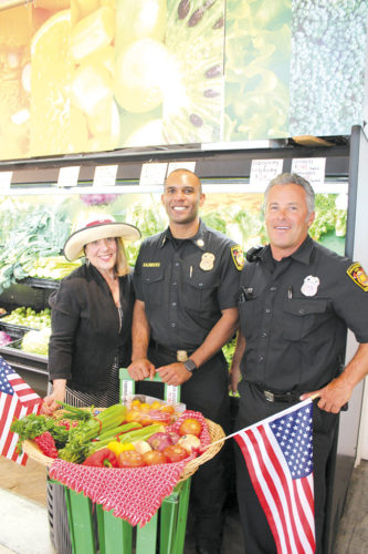Lyn MacEwen Cohen, president of the First-In Fire Foundation, joined firefighter Sean Millett and battalion chief Orin Saunders to procure the groceries needed for their chili. The vegetables were donated by  Greenhouse Produce. (photo courtesy of Lyn McEwen Cohen)