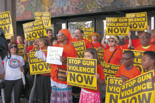 Proponents of gun control measures rallied at Los Angeles City Hall last July prior to the city council approving a ban on high-capacity gun magazines. A year later, a ban on the magazines has been extended statewide. (photo by Edwin Folven)