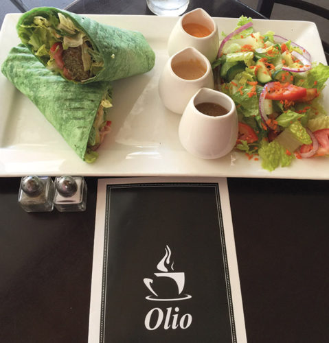 New menu items at Olio Crepe Kitchen include the fallafel spinach wrap, served with three sauces. The falafel is air-dried, rather than fried, resulting in a lighter version of this popular Mediterranean sandwich. (photo by Jill Weinlein)