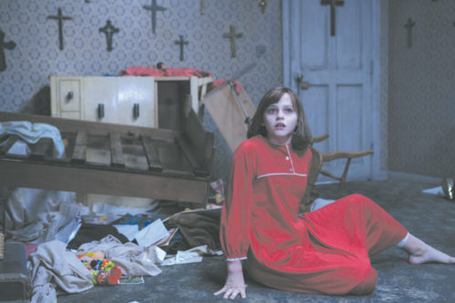 "Madison Wolfe appears as Janet Hodgson, a girl haunted by an evil entity in ""The Conjuring 2."" (photo courtesy of Warner Bros. Pictures)"
