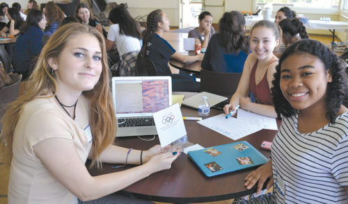 Gril Up Club board officers from left are senior Taite Hylton, junior Audrey Reames and sophomore Grace Egbe planning activities for the coming year. (photo courtesy of Immaculate Heart)