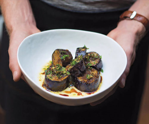 Wood-fired eggplant with vin cotto, garlic, olive oil and parmesan has the texture of scallops and an essence of charcoal. (photo courtesy of Kettle Black)