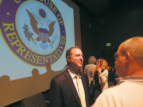 Congressman Adam Schiff met with audience members after the town hall meeting on gun violence.