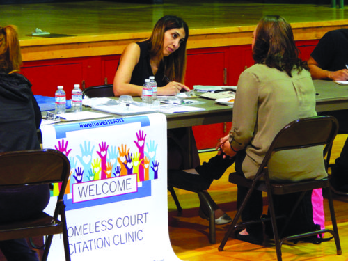 Deputy City Attorney Nooshi Zahiri Naderi talks with an attendee at the Homeless Connect Day event at Pan Pacific Park Senior Center. (photo by Edwin Folven
