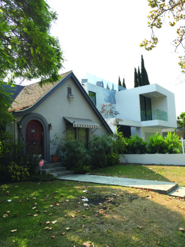 """McMansions"" like the house on the right have been invading the Miracle Mile for years. (photo by Gregory Cornfield)"