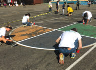 Volunteers get their hands dirty for the kids at Ramona Elementary