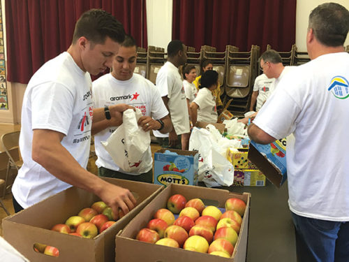 Healthy snacks empower students at Ramona Elementary School in Hollywood. Approximately 140 volunteers lent a hand in preparing the snack bags, repainting and cleaning up the campus. (photo by Brent Giannotta)