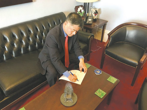 Congressman Ted Lieu signs the bill to restrict nuclear arms use. (courtesy of Congressman Ted Lieu's office)