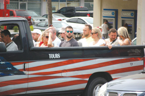 Concerns have surfaced over tour bus safety, particularly with open-air vans. (photo by Gregory Cornfield)