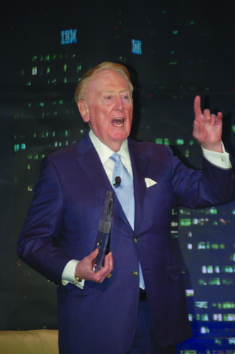 Scully gets the crowd's attention in February after receiving a Lifetime Achievement award from the Los Angeles Sports Council. (photo by Gregory Cornfield)
