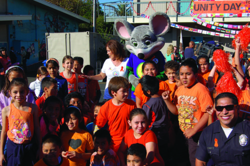 Students at Santa Monica Boulevard Community Charter School celebrate Unity Day on Wednesday with LAPD and Chuck E. Cheese. (photo by Brent Giannotta)