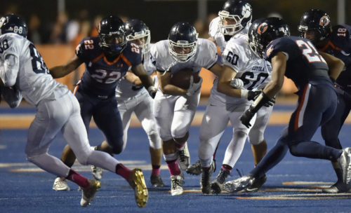Senior running back Patrick O'Reilly goes for one of his seven carries in the Cubs' 42-0 loss to Chaminade on Oct. 7. (Photo courtesy of Judy Heinan)
