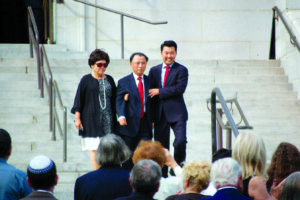 (photo by Edwin Folven) Councilman David Ryu, right, walks with his parents after he was sworn into office in 2015.