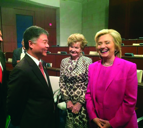 Congressman Ted Lieu, left, laughs with then-candidate Hillary Clinton. In the first week since President-elect Donald Trump beat Clinton, Lieu has been monitoring the real estate mogul's every move. (courtesy of Congressman Ted Lieu's office)