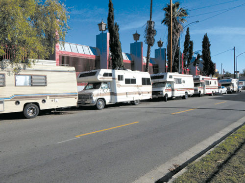 People sleeping in recreational vehicles park on roads near Cahuenga Boulevard and Vine Street in Hollywood. Under new regulations, vehicles will be allowed overnight in commercial areas. (photo by Edwin Folven)