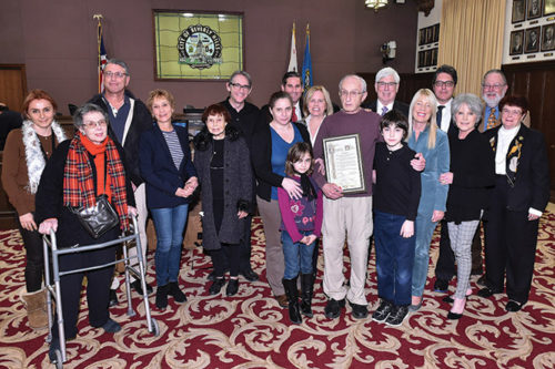 Asher Waxman (holing proclamation) recently received the 5th annual Embrace Civility Award, and was joined by family and friends. (photo courtesy city of Beverly Hills)