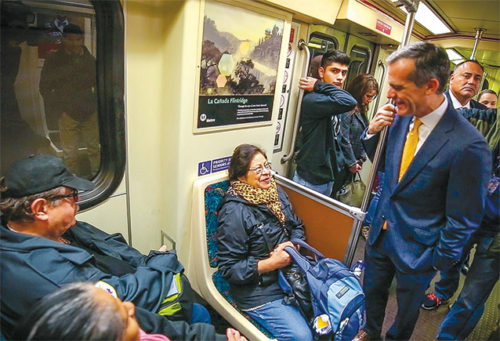 Mayor Eric Garretti rode the Metro Red Line subway on Dec. 6 to demonstrate it is safe. (photo courtesy of Mayor Eric Garrett's Office)