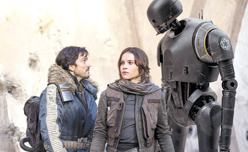 "Diego Luna stars as Cassian Andor, Felicity Jones appears as Jyn Erso and Alan Tudyk voices the droid K-2SO in ""Rogue One: A Star Wars Story."" (photo courtesy of Disney Pictures)"