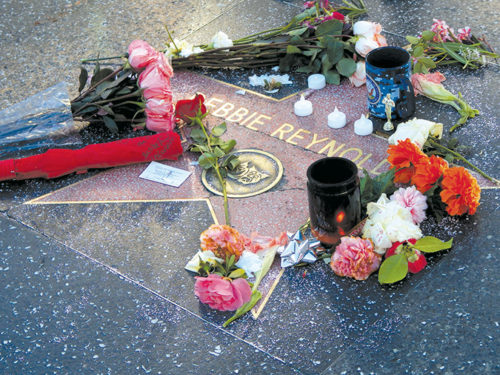 A memorial was placed at the Hollywood Walk of Fame star of Debbie Reynolds. (photo by Edwin Folven)