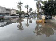 Water main break floods street, carport